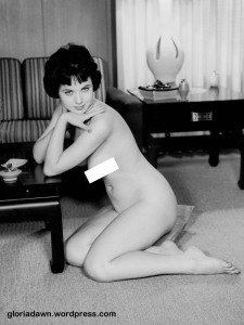 Another photo of me fully nude sitting on the floor.  If I look a bit