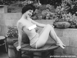 LeRoy took a number of photos of me on or near a round wooden table.  The frilly pants were his.  One of the set was published in Monsieur, 1964, but not this one.