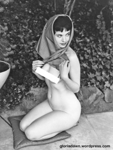LeRoy took a group of photos of me sitting on pillows on a sidewalk.  None were every published.  In this one, I had a scarf on my head but was wearing nothing else.