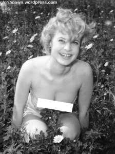 This was a photo taken in a windy field.  I was wearing my own bathing suit.  I owned this suit for about 3 years.  Never published.