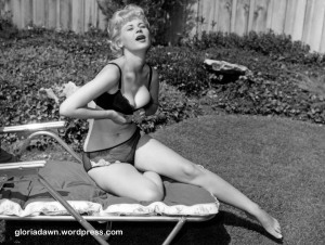 Here I am opening my bra.  A version of this photo appeared in Black Silk Stockings, 1965.